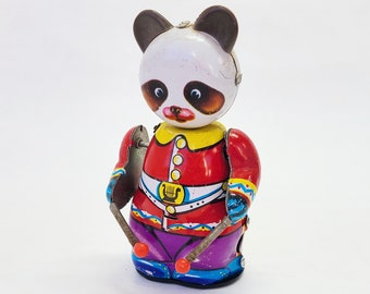 collectible panda bear panda wind up toy early seventies Chinese tin toy Vintage panda tin toy red suit panda toy