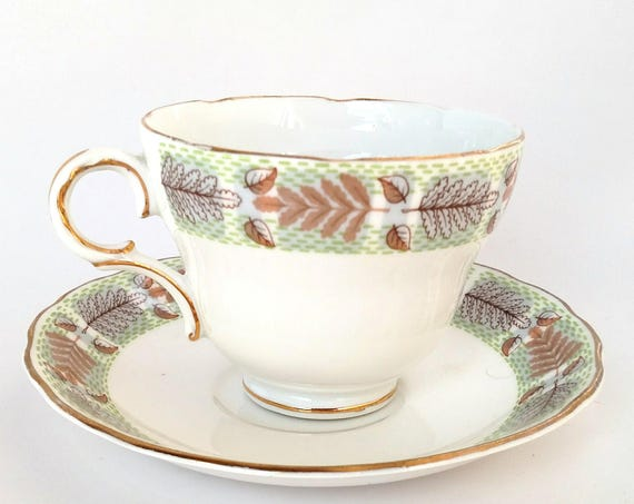 Vintage Melba Bone China Teacup and Saucer Set with Foliage Design in Green, Chestnut and Gold