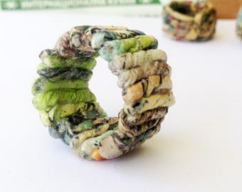 Upcycled newpaper ring – unisex gift for first wedding anniversary. Recycled newspaper jewelry made to order in your size. Green accent.