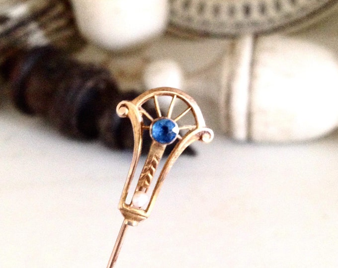 Late 1800's 10k yellow gold stick pin with sapphire and seed pearl in Art Nouveau style