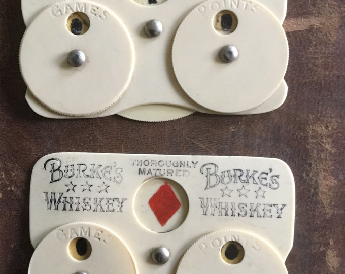 Pair of Rare pre-prohibition Burke's Whisky Advertising celluloid Whist card game counters, c. 1900-1910