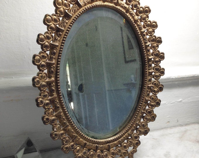 Late 19th Century Brass framed Shamrock or clover mirror, with lovely distressed original glass mirror