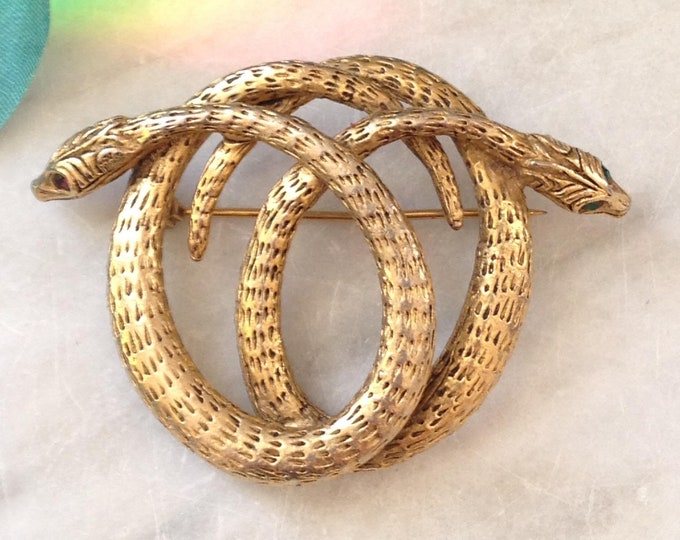 Entwined Double snake brooch, gold tone with red and green eyes vintage costume pin