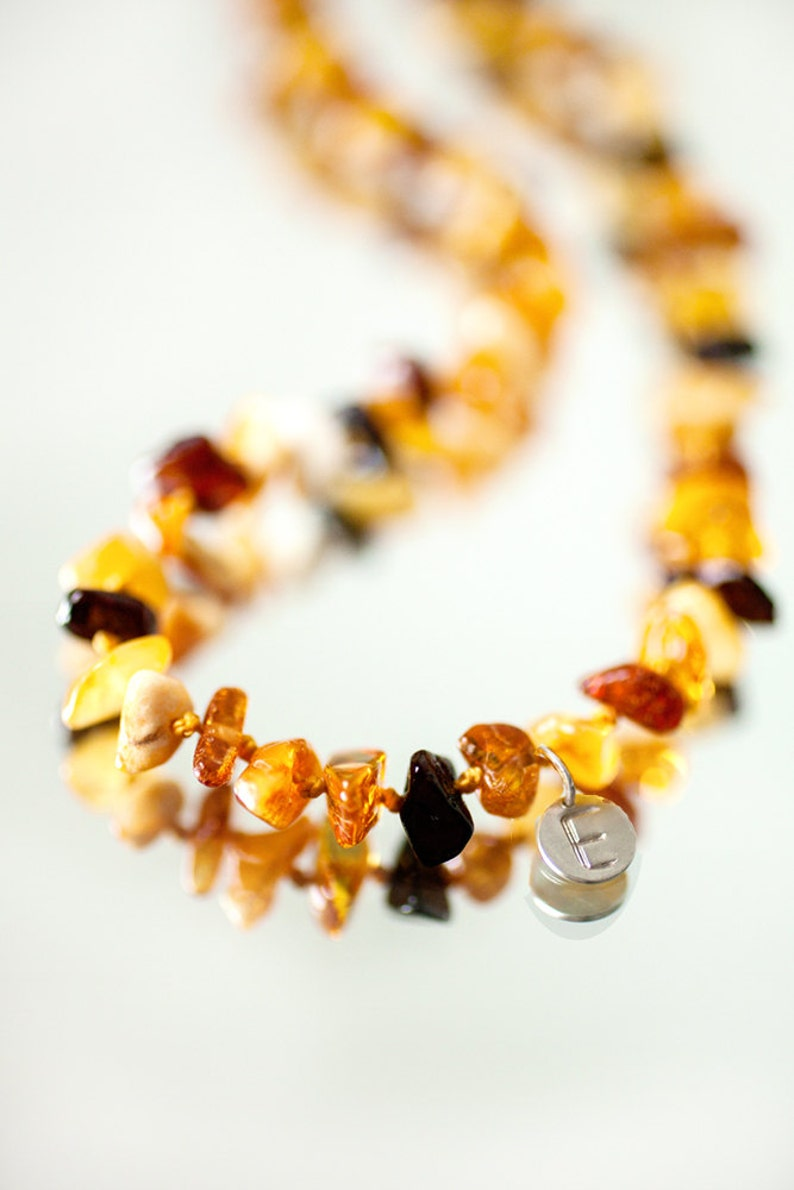 Personalized Baby teething necklace from mixed colour Baltic image 0