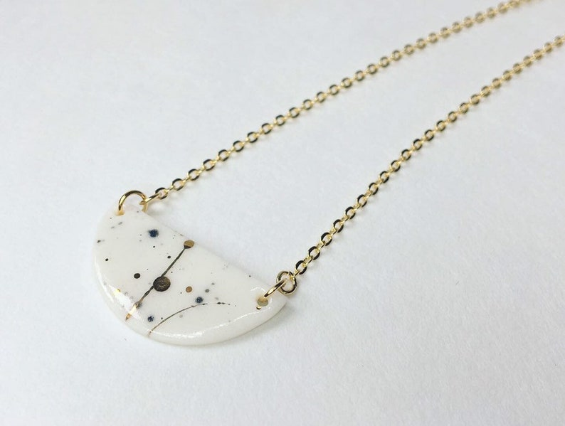 Gold galaxy half moon porcelain necklace image 0