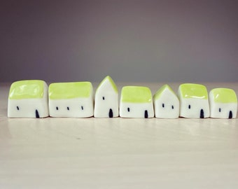 Set of 7 miniature village of tiny houses with green roofs ornament