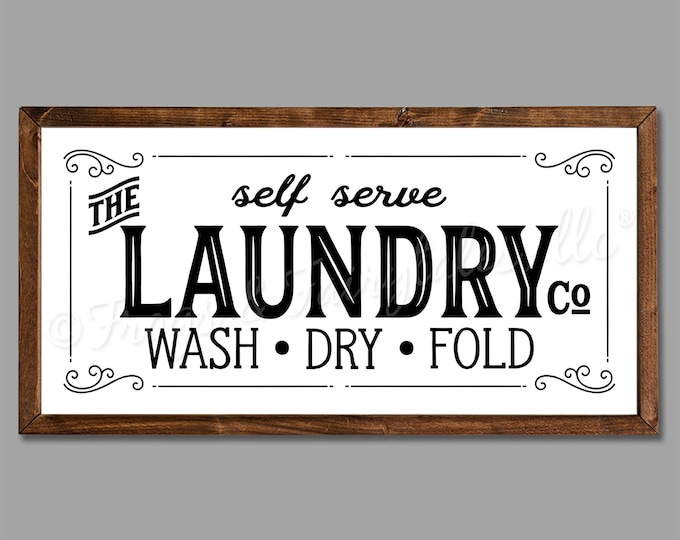 """The Laundry Co 36""""x18"""" Vintage Laundry Room Sign Wooden Framed Canvas Print"""