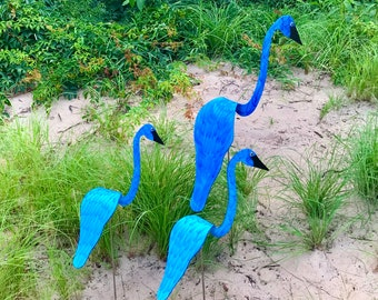 Family SET of 3 in Caribbean Blue. One swirling bird with 2 smaller spinners. They swirl, spin and bob up and down with the garden breezes.