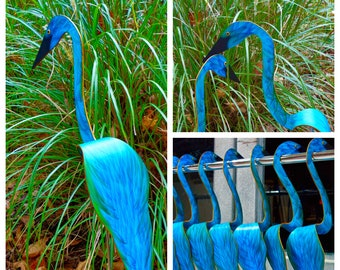 Swirling Bird in Peacock Blue-Green Feather designs. Our kinetic birds swirl with the slightest breeze.