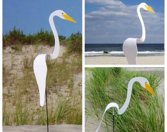 White Swirling Bird, whimsical kinetic art for the garden. Our PVC original spinning bird bobs and swirls around with the slightest breeze.