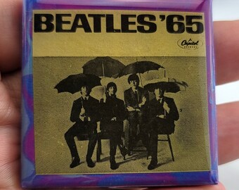 Beatles 65 Ceramic necklace made from AUTHENTIC album sleeve insert.  This piece of music history is 56 years old!