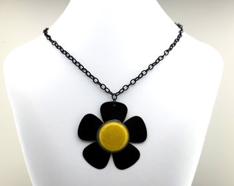 Daisy Guitar Pick Necklace - Five Black Guitar Picks with Yellow center to create a daisy flower necklace.  Black metal chain included