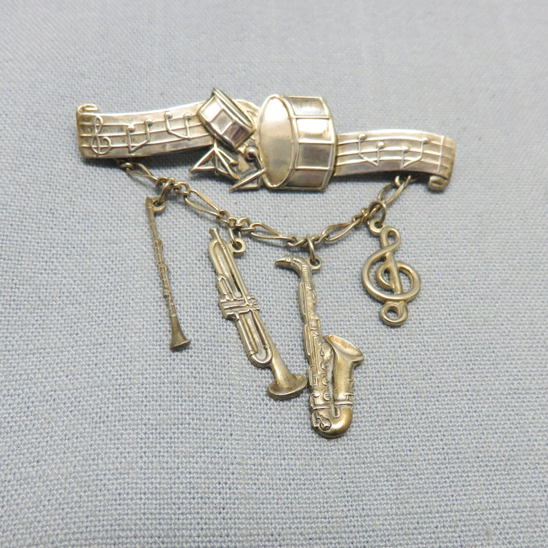 1970s  Sterling Silver Band and Musical Instruments Pin