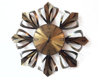 Mid Century Modern Wall Clock Sunburst Flower by German Atlanta Made of Brass and Metal