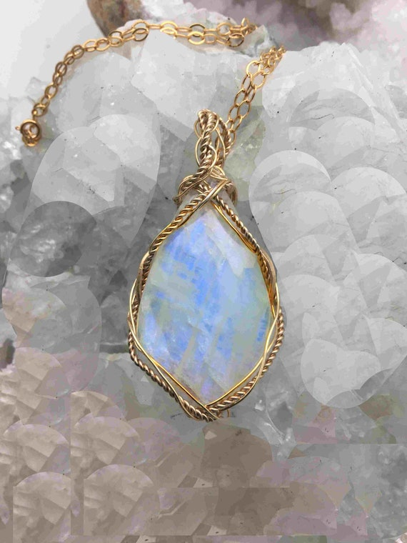 Beautiful Rainbow Moonstone Necklace wrapped in Gold Plated Wire Hanging from a Gold Chain - Handmade in the USA
