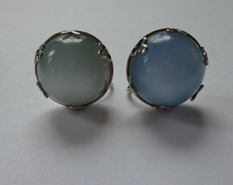 Vintage pair of Blue Thermoset Lucite Screw Back Earrings Button Shape