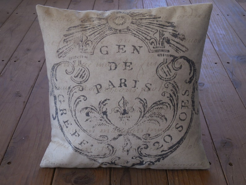 French seal burlap pillow and and 25 Beautifully Handmade Decor Finds for Home to help you feather your nest and also inspire your interior design schemes.