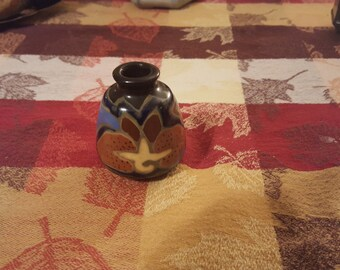 Unique colorful miniature vase or toothpick holder.