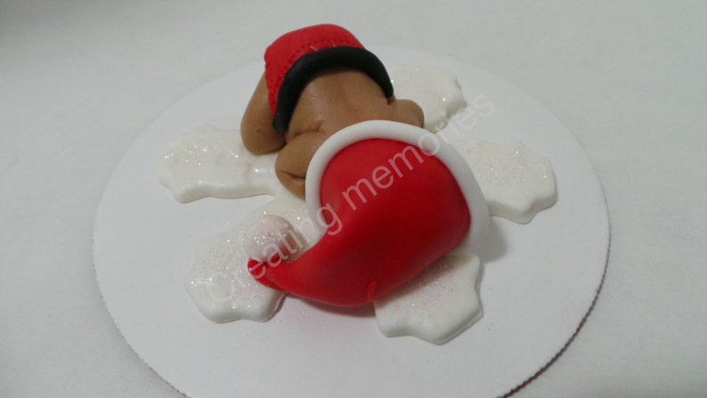 He is ready for the holidays Baby Boy in a Christmas Outfit Cake Topper Made of Vanilla Fondant