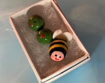 A tiny Bee and 2 Peas.Porcelain Bee and Peas .3 Mini ceramic green Peas.Ceramic Bee.Cute gift .Handmade in Wales ,Uk