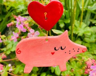 Love heart Pig Decoration.Ceramic Pink Pig with red love heart button.Porcelain Pig  Ornament. Folk art style pig decoration.