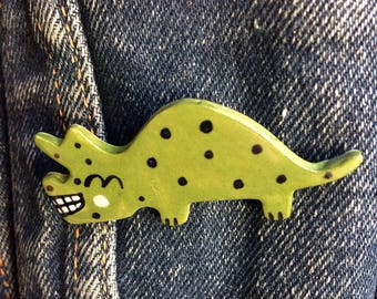 Dinosaur Badge/pin/button/badge.Ceramic/porcelain.Triceratops.Handmade.Made in Wales,Uk
