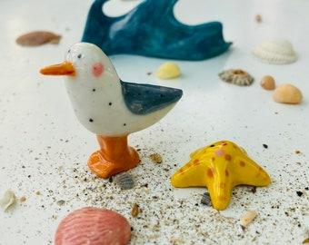 Seagull and starfish Figure decoration.Ceramic/Porcelain Seagull /starfish ornament .Seaside gift.Handmade in Wales ,Uk
