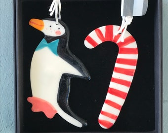 Penguin and Candy cane ceramic Decorations.Porcelain christmas Tree ornament/Christmas decorations/kitsch decorations.Handmade in wales uk