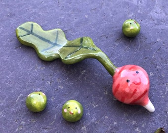 Ceramic Radish and peas Ornament .Mini ceramic Radish figure with face and garden peas.Cute vegetable ornaments.Handmade in Wales ,Uk