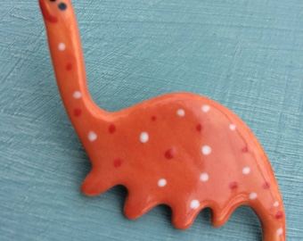 Dinosaur Brooch/pin/button/badge.Ceramic/porcelain .Diplodocus.Handmade.Made in Wales,Uk