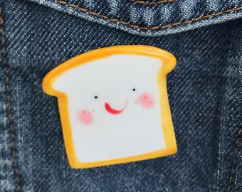 Toast badge ceramic .Ceramic/Porcelain brooch/pin/button/badge.Happy toast jewellery.Handmade in Wales,Uk.