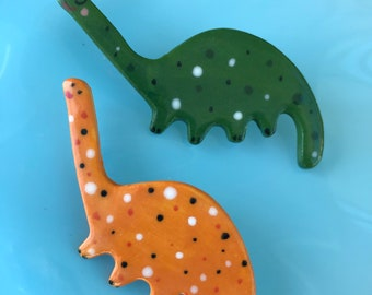 Dinosaur Brooch/pin/button/badge.Ceramic/porcelain .Gift for boy.Diplodocus.Handmade.Made in Wales,Uk