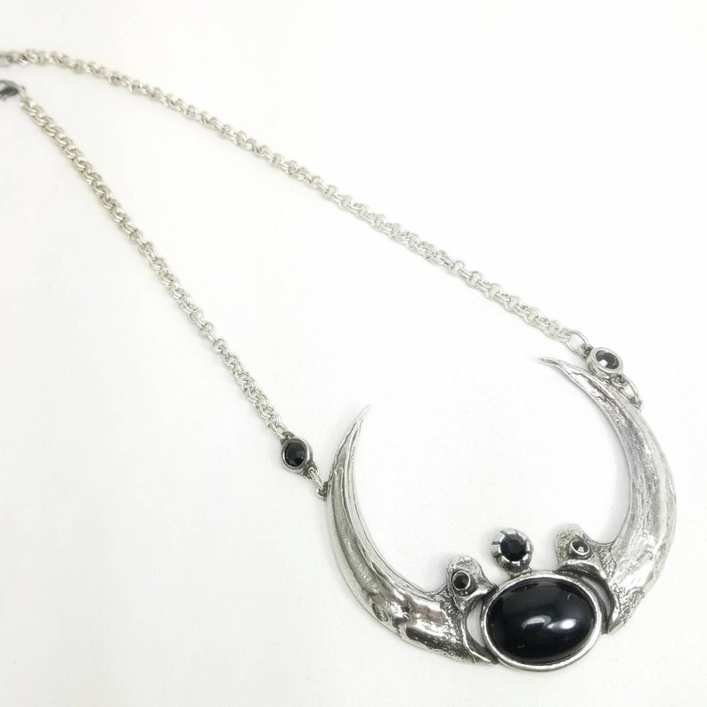 Harpy Eagle Claw Necklace with black glass.