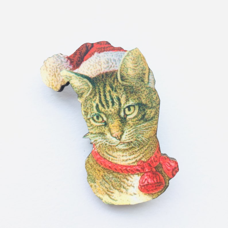 Tabby Cat with Santa Hat and Red Ribbon  Portrait Face image 0