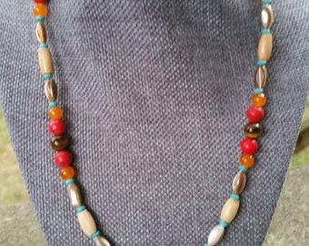 and bone hairpipe red bamboo coral Striking turquoise howlite Native-inspired 20 inch necklace and earrings set featuring metal beads