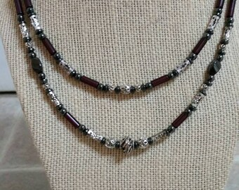 Exquisite, 18 inch and 16 inch double strand necklace featuring inlaid metal beads and tubes, hematite, and purple french glass wampum beads