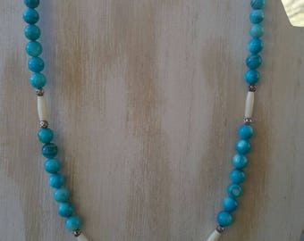 Casual, beach-themed 20 inch light blue shell beads, bone hairpipe, round metal beads