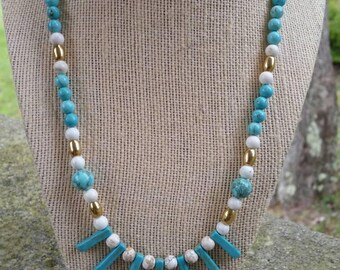 Native-inspired, 20 inch turquoise howlite fan necklace with white howlite  beads, turquoise howlite beads, and brass melon beads