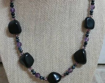 Protective, 19 inch necklace featuring black tourmaline nuggets, Swarovski crystals, snowflake obsidian, amethyst, hematite, and hornpipe