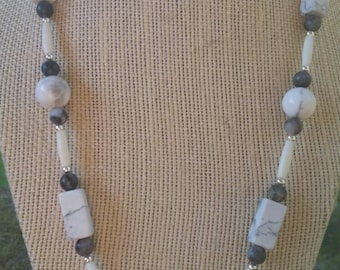 Exquisite, 20 inch necklace featuring white howlite beads and recrangles, network stone beads, sterling silver beads, and hairpipe tubes