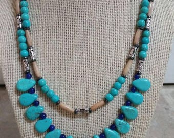 Dazzling, Native-inspired, 18 inch and 20 inch, two-strand necklace featuring turquoise howlite, lapis lazuli, hairpipe, and hematite