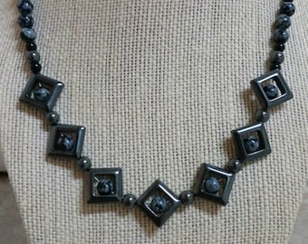 Protective, 18 inch necklace featuring hematite diamonds, snowflake obsidian, black tourmaline beads, and hematite beads