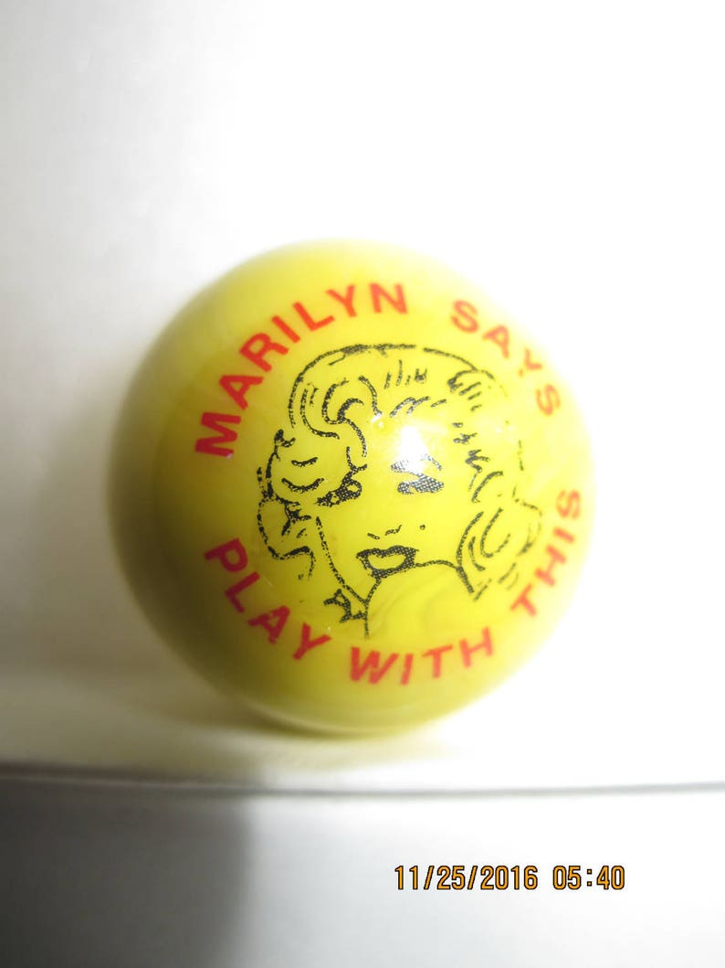 ANTIQUE Awesome MARILYN MONROE Yellow,Red,/& Black /' Marilyn Says Play With This/' Marble Shooter Size...Excellent Condition