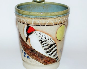 Pottery Mug Wood Pecker on a Tree Basking in the Sun