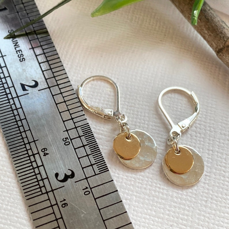 Tiny simple silver and gold disc earrings for every day use small 14 K gold filled and silver disc texturized Gold and silver earrings