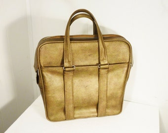 metallic gold vintage American Tourister suitcase carry all