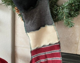Holiday Christmas stocking made from wool sweaters with jingle bell on toe
