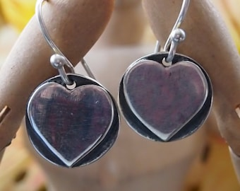 Cute simple handmade hearts on a disc in fine silver on sterling silver wires.