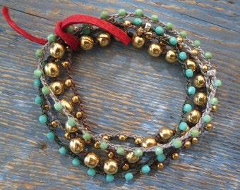Set of 5 roll bracelets.