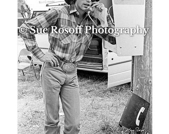 Lane Frost Talking on the Pay Phone wearing aviator glasses 842f96c78e2